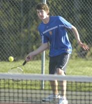 by: David Ball, Barlow's No. 4 singles player Mike Bates returns a shot during his three-set win Thursday afternoon against Gresham.