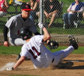 by: timothy j. park, Oregon City pitcher Leif Gambee puts the tag on Milwaukie senior Jacob Waker as Waker attempts to score during last Thursday's game.