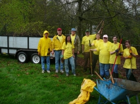 by: contributed photo, Despite the need for yellow slickers, it was all smiles as members of the Damascus-Boring Kiwanis club cleaned up the Damascus Community Park on Saturday, April 7.