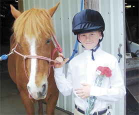 by: Courtesy Photo, Philip Hunter Kollar, 11, was an avid horseman. He also loved to fish and hike. His classmates at Banks Elementary School, however, will remember his smile the most.