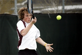 by: Chase Allgood, Forest Grove sophomore Brett Baumgartner rips a forehand during last Wednesday's tennis match.