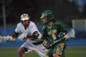 by: Vern Uyetake, The Lions' Neil Parikh, right, winds up for a pass as a Lakeridge defender looks on during Tuesday's 17-5 loss to Lakeridge. West Linn fell behind 11-0 against the defending state champions but rallied in the second half.