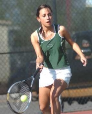 by: DAN BROOD, SMACK IT — Tigard senior Daniella Armi hits a forehand shot in the No. 2 doubles match at McMinnville.