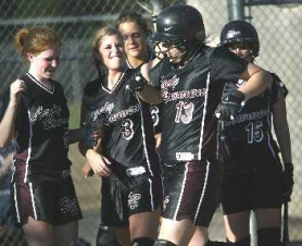 by: JAIME VALDEZ, HOME RUN HITTER — Sherwood's Brittany Morales (13) is congratulated by teammates after belting a home run in the Bowmen's game with Century.