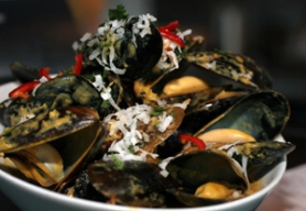by: DENISE FARWELL, Chef David Anderson's travels are the inspiration for a series of Sunday dinners at Vindalho. The restaurant's Goan-style mussels follow a preparation from India's west coast.