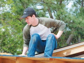 by: contributed photo, Kenny Russell helps install a new roof at Joy Fellowship Church in Slidell, La.