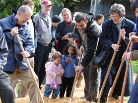 by: Jessie Kirk, Neighbors and community leaders gather at Multnomah Village Park to ceremoniously turn dirt as the park's groundbreaking April 9.