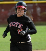 by: Zack Palmer, Pacific freshman Brooke Fogwell smiles while rounding the bases after hitting a two-run home run in the fifth inning on Saturday.