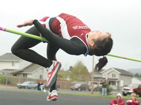 by: Tommy Whitcomb, Forest Grove's Sarah Amina clears the bar during last Wednesday's high jump competition.