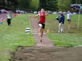 by: Michael Cade, Sandy freshman Katie Pelchar en route to her finish in the triple jump.