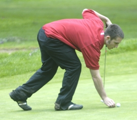 by: David Ball, Junior Josh Hardin gauges his putting distance at Portland's Glendoveer Golf Course April 11.