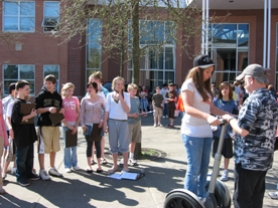 by: Cindy Garrison, Gabby Estey concentrates on driving the Segway owned by Mike Ooten. Waiting their turn behind her are Peyton Snell, Maria Green and Nicholas Parker.