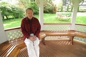 by: Vern Uyetake, Terry Cone, 68, sits within a gazebo he built on land he owns next to his property. The area is casually known to neighbors as Cone Park, as it is a gathering hub for all who live on Skyland Circle. The grassy area includes a swing, rotating flower arrangements and light pole.