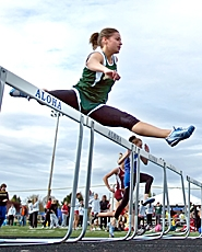 by: JOHN LARIVIERE, HURDLE STARS – Jesuit's Jessica Monk catches some air during her heat of the high hurdles at Friday's Aloha Relays.