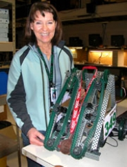 "by: Barbara Sherman, READY FOR WAR — Tigard High School technology teacher and robotics club advisor Stevie Viaene is proud of ""Warhammer,"" the robot that the club built and entered in a recent competition."