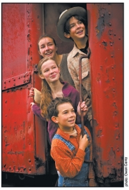 "by: ©2006 OWEN CAREY, Home is a train in 'The Boxcar Children,"" an Oregon Children's Theatre production set during the Depression."