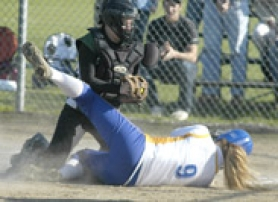 by: David Ball, Reynolds catcher Gabby Stover tags out Barlow baserunner Kristel Baeckel in a play at the plate during the Raiders' 3-0 win Friday.