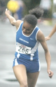 by: David Ball, Gresham sprinter Schavey Hill leans through the finish line during her winning effort in the 100-meter dash at the Centennial Invitational on Saturday night.