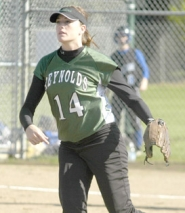 by: David Ball, Reynolds pitcher Kelli Eubanks watches her throw to third base after fielding a bunt during the Raiders' 3-0 win against Gresham on Monday.