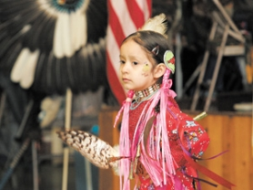 by: Shanda Tice, Representing the Confederated Tribes of Umatilla is dancer Atusha Greene, 5 who dances with ribbons streaming behind her at the ninth annual Spring Pow Wow held last Saturday at Glenn Otto Park.