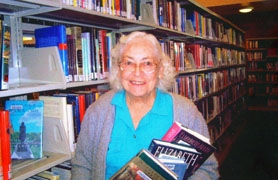 by: Submitted Photo, A SHELVING ANGEL — An undated photo of Dorothy Howard shows the 45-year Tualatin resident at the Tualatin Public Library where she volunteered nearly 9,000 in the last 20 years. Howard died in March and was posthumously named Tualatin's 2006 Distinguished Citizen by the Tualatin Chamber of Commerce last week.