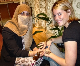by: Merry MacKinnon, Sanya Khan, whose Henna Body Art studio is at 1622 S.E. Bybee Boulevard, paints traditional  designs on Heidi McKay's hands. A resident of Brooklyn neighborhood, McKay had her hands ornamented just for the fun of it.