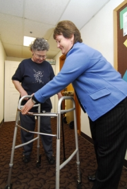by: Vern Uyetake, Mollie Clark  gets help with her walker from Dana Tassos, client services coordinator for the Lake Oswego Adult Community Center.