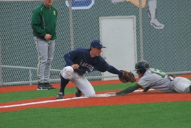 by: Vern Uyetake, Lake Oswego third baseman Cooper Mandelblatt just misses tagging out a West Linn runner during last Friday's TRL game, which the Lions won 7-3. The Lakers rebounded from that loss to beat Putnam 6-5 on Monday.