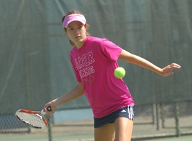 by: Vern Uyetake, Lake Oswego's Madeline Parker returns a shot during last week's district tennis tournament. Parker went on to win the singles title and is one of seven Lakers headed to this week's state tournament.