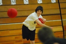 by: Vern Uyetake, Sam Britton shows his passion for the game of dodgeball as a local high school league held its third annual championship tournament last week. This year's title was won by Team Brady, which wore NBA throw-back jerseys.