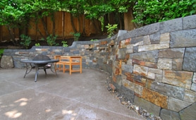 by: Vern Uyetake, Rock mason Matt Goddard of Poetry in Stone replaced two decks in a Lake Oswego backyard with a curved masterpiece made of stone.