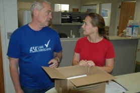 by: Sam Bennett, John Surrett of Ask Lake Oswegans handed city recorder Robyn Christie about 4,200 signatures for a November ballot measure last week.