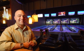 by: Vern Uyetake, Players' manager Josh Sciaccoti gets the facility's new high tech bowling alley ready for action last week.