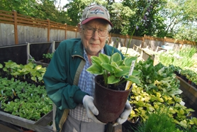 by: Vern Uyetake, James Skinner, 87, of Lake Oswego holds a potted plant within his backyard. Skinner often gardens to maintain the property — a special place he and his wife Elsie started together many years ago before she passed away.