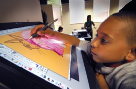 by: Vern Uyetake, Jalen Lowery, 7, of Lake  Oswego has fun creating digital art using the pen -enabled display in the demonstration area of the digital art exhibit  in the  Lakewood Center.