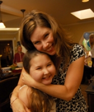 by: Vern Uyetake, Labri Dirkse, a Lake Oswego girl who has a terminal brain tumor, hugs her mom, Heidi Dirkse-Graw.