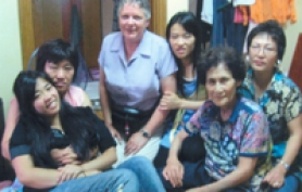 by: Submitted Photo, During a trip to South Korea, Lake Oswego native Robin Gellinger, far left in front, cozies up to her birth mother, along with, from left, her mom Cindy Gellinger, Robin's biological sister, Robin's biological grandmother and Robin's biological aunt.