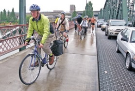 by: Jim clark, Cyclists make their morning commute over the Hawthorne Bridge alongside motorists. People's transportation choices – and how they affect others – continue to stir up passions on all sides of the road.