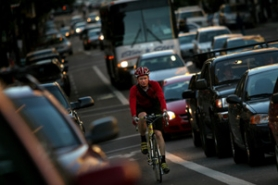 by: David Plechl, Bicycle commuter Lee Shaver zips past backed-up car traffic on his way home from work. Readers had a lot to say about recent stories detailing more plans for bike programs.