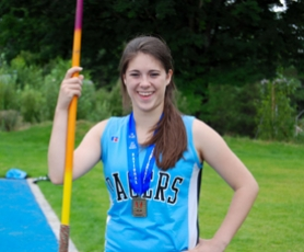 by: submitted photo, Lakeridge javelin thrower Andrea Hopkins poses with the first-place medal she recently won at the national Junior Olympics track meet in California. Hopkins had four career-best throws during the meet, including a winning effort of 146-3.