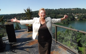 by: Vern Uyetake, Principal Broker Barbara Sue Seal spins around on the patio in the backyard of her home overlooking Oswego Lake. Seal purchased the home in 1986, saying she rarely moves but enjoys helping others find new homes. After forming Barbara Sue Seal Properties in 1983, Seal has maintained a loyal clientele and busy schedule.