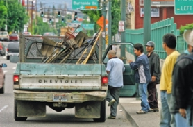 by:  L.E. BASKOW, Day laborers get into the cab of a truck with the promise of work. While the city considers building a shelter for day workers, some say this type of temporary-help agency still must follow the laws.