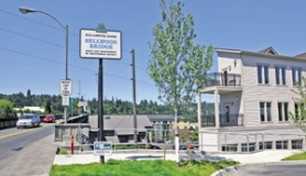 by: JIM CLARK, One option for a new Sellwood Bridge that would save occupied condos from being demolished would doom this new mixed-use building on Southeast Grant Avenue and Tacoma Street.