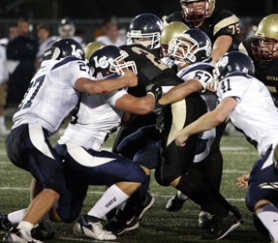 by: Miles Vance, Lake Oswego's swarming defense played a key role in the Lakers' 21-17 non-league victory at Southridge last Friday night. On this play, LO's (from left) Garrett Cook, Billy Lee, Jeff Kremer and Matt Tellam put the clamps on Southridge quarterback Kellen Mastrud.