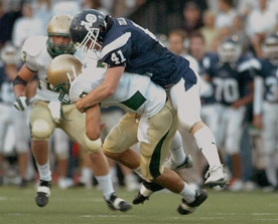 by: Vern Uyetake, It was Lake Oswego's first-ever victory over Jesuit after three previous losses. It was also the first time since 1990 that Jesuit had been shut out. A number of players were instrumental in Friday's victory, including Jay Matthews, who intercepted a pass late in the first half. Matt Tellam, pictured, sacked Jesuit quarterback Scott Williams before he had a chance to find a receiver.