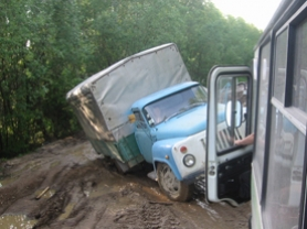 by: Courtesy Agape Medical Center in Moscow, An Agape Medical Center transport truck becomes mired in the mud on a rural road outside of Moscow.