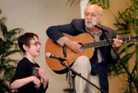 "by: Vern Uyetake, Rebecca Recht, a Park Academy student born with cerebral palsy, sings ""Don't Laugh at Me"" with her friend, Peter Yarrow of Peter, Paul & Mary."