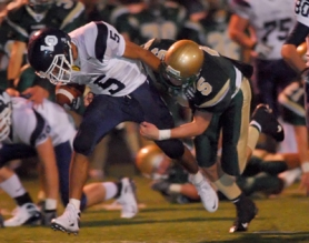 by: Vern Uyetake, Lake Oswego's Zach Young tries to break free from the grasp of West Linn's Justin Monahan. Young broke tackles throughout the second half of Thursday's game running for 271 yards and three touchdowns giving the Lakers a 29-12 win at West Linn.