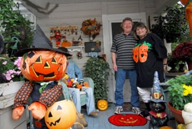 by: Vern Uyetake, Mike and his wife Chris Holmstedt, shown below, take a break from decorating their front porch on the corner of 4th Street and C Avenue.