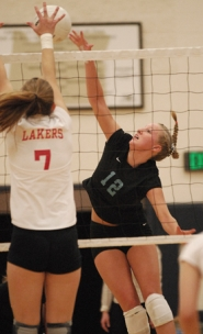 by: Vern Uyetake, Lakeridge's Sydney Aldrich, right, tries to squeeze a hit past Lake Oswego's Devon Brown during Tuesday TRL match. The Pacers won the match in four sets to remain in second place in the league standings.